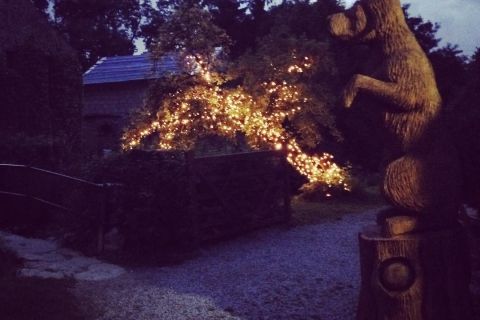 Carving by lighted tree